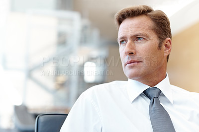 Buy stock photo A handsome businessman deep in thought