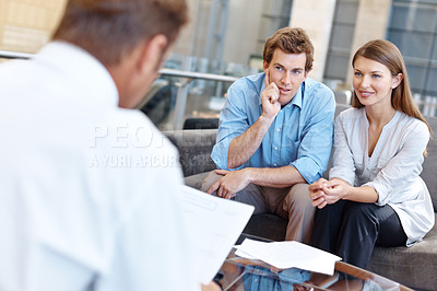Buy stock photo A fiancial advisor giving advice to a couple