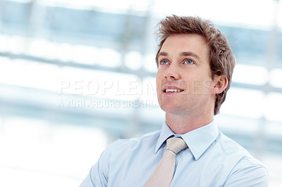 Buy stock photo Handsome young businessman standing alongside copyspace indoors
