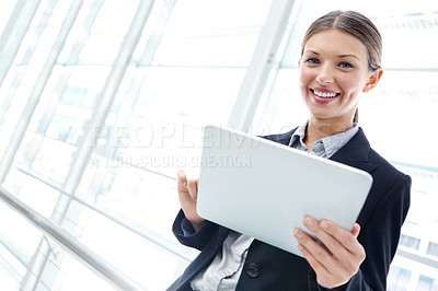 Buy stock photo Beautiful young businesswoman using a digital tablet