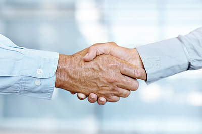 Buy stock photo Cropped view of two businessmen shaking hands