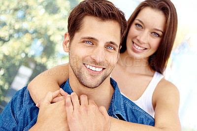 Buy stock photo Portrait of a smiling affectionate couple who are outside