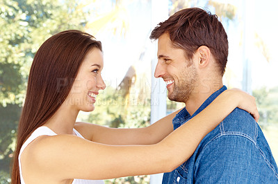 Buy stock photo A smiling happy couple sharing a moment and being affectionate