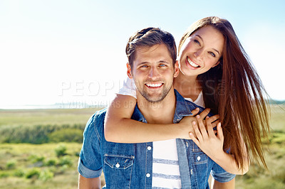 Buy stock photo A portrait of a happy smiling couple in the outdoors