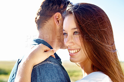 Buy stock photo A happy girlfriend hugging her boyfriend while standing outside