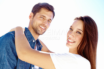 Buy stock photo Portrait of a happy affectionate couple standing outside