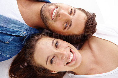 Buy stock photo A smiling couple with their heads together