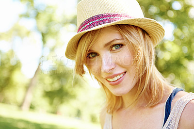 Buy stock photo Portrait of a pretty blonde in the park with a hat on