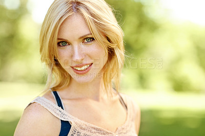 Buy stock photo Portrait of a beautiful young smiling woman in a outdoor environment