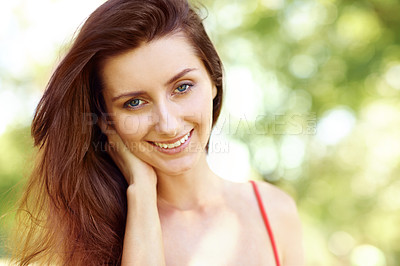 Buy stock photo Portrait of a beautiful young woman smiling in an outdoor environment