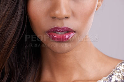 Buy stock photo Cropped studio shot of a woman's luscious pink lips against a gray background