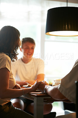 Buy stock photo Cropped shot of a family praying before dinner