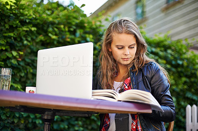 Buy stock photo Portrait of a beautiful teen working on her laptop at a bistro