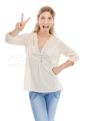 Buy stock photo Studio shot of an attractive young woman showing you the peace sign while sticking out her tongue against a white background