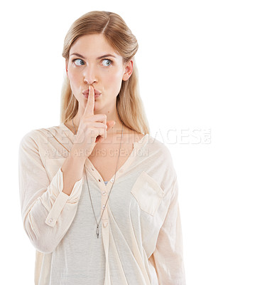 Buy stock photo Studio shot of an attractive young woman posing with her finger on her lips against a white background