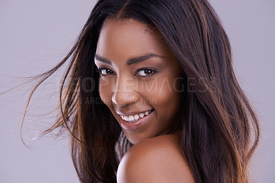 Buy stock photo Portrait of a beautiful young woman looking over her shoulder in the studio