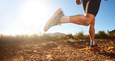 Buy stock photo Cropped shot of a man running on off road terrain