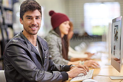 Buy stock photo Shot of students working on computers in a university library