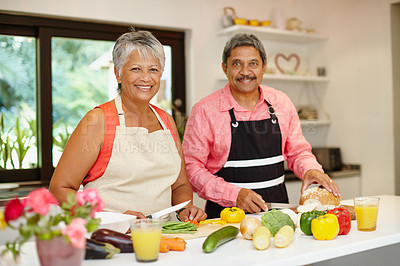 Buy stock photo Shot of a happy senior couple cooking a healthy meal together at home