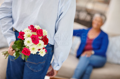 Buy stock photo Shot of a senior woman receiving a surprise bunch of flowers from her husband