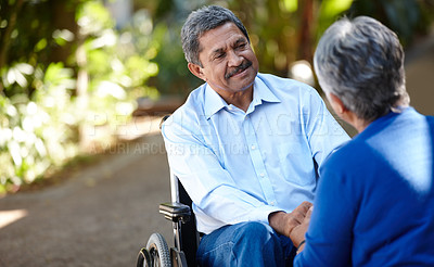 Buy stock photo Cropped shot of a senior couple talking outdoors