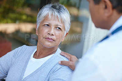 Buy stock photo Cropped shot of a senior woman listening to her doctor