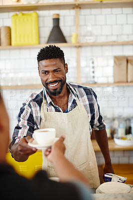 Buy stock photo Cropped shot of a handsome young man serving a customer in his coffee shop