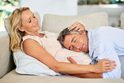 Buy stock photo Shot of a mature couple sharing a tender moment together while relaxing at home