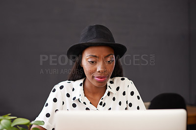 Buy stock photo Shot of a young designer working on her laptop
