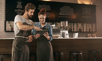 Buy stock photo Cropped shot of a two young coworkers working in a cafe