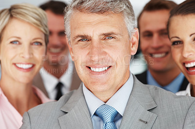 Buy stock photo Closeup portrait of a happy mature businessman standing with his team