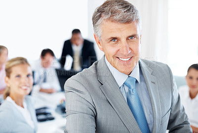 Buy stock photo Portrait of a successful senior manager smiling and his team in a meeting at office