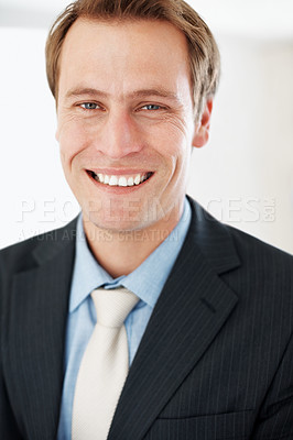Buy stock photo Closeup portrait of a smiling young businessman looking - Successful young businessman
