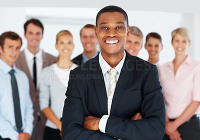 Buy stock photo Portrait of a successful american african businessman smiling leading his team