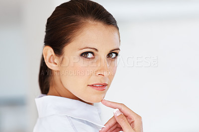 Buy stock photo Portrait of a pretty young business woman looking confidently at you in office