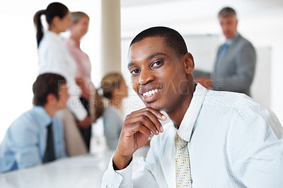 Buy stock photo Portrait of an african american businessman smiling during a presentation in board room
