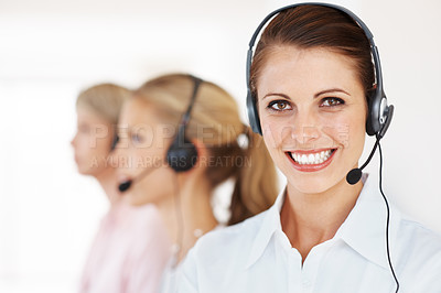 Buy stock photo Portrait of a pretty call center executive with colleagues in background
