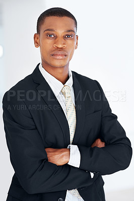 Buy stock photo Portrait of a confident young american african businessman looking with attitude