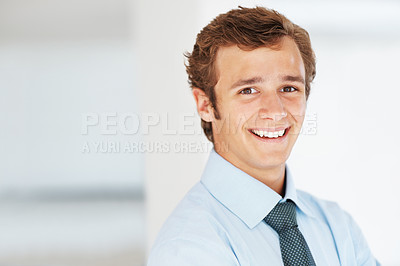 Buy stock photo Portrait of a confident young male business executive smiling