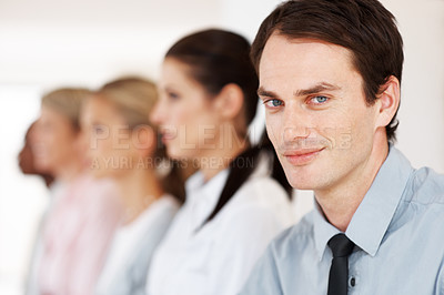 Buy stock photo Closeup of a mature businessman sitting in a meeting with his colleagues in background