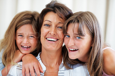 Buy stock photo Closeup portrait of mother and two daughters smiling