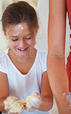 Buy stock photo Young girl holding dough in her hand and playing with it