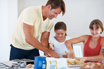 Buy stock photo Family having fun together and baking pastries in the kitchen