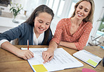 Giving her daughter a helping hand with her homework