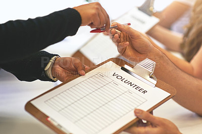 Buy stock photo Cropped shot of volunteer getting signatures for church donations