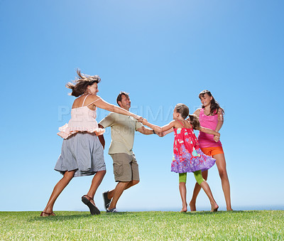 Buy stock photo Full length of family holding hands and circling - copyspace