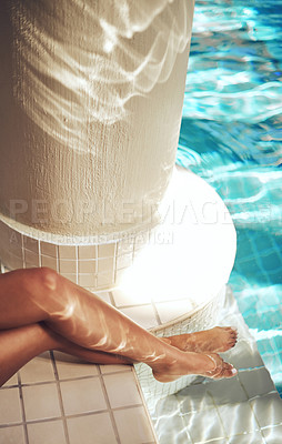 Buy stock photo Cropped shot of a woman's feet in the water of a spa pool