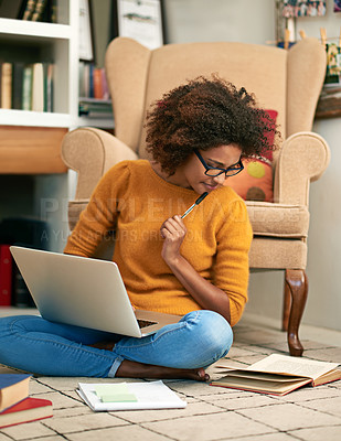 Buy stock photo Full length shot of a young woman using her laptop to study