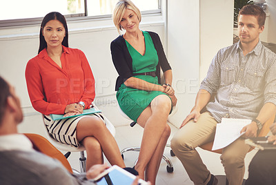 Buy stock photo High angle shot of a group of coworkers sitting in a meeting