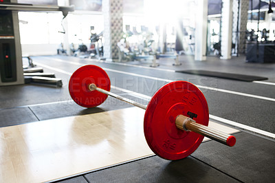 Buy stock photo Shot of a weights on a gym floor